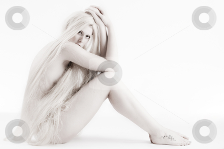 Long blond haired artistic beauty flirting with you stock photo, High key studio shot a an artistic girl with very long blond hair by Frenk and Danielle Kaufmann