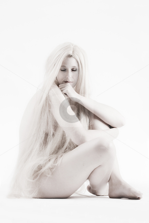 Long blond haired artistic beauty thinking stock photo, High key studio shot a an artistic girl with very long blond hair by Frenk and Danielle Kaufmann