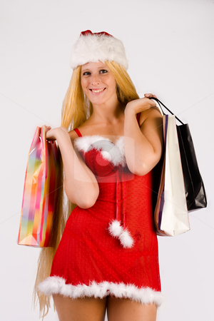 Christmas faerie doing xmas shopping stock photo, Studio portrait of blond christmas girl with very long blond hair and shopping bags by Frenk and Danielle Kaufmann