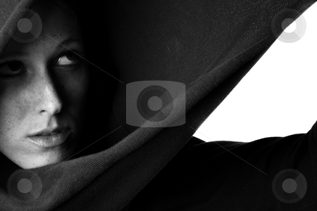 Feeling trapped im my turtleneck sweater stock photo, Studio portrait of a beautifull girl in a hooded sweater by Frenk and Danielle Kaufmann