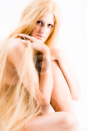 Long blond haired artistic beauty stock photo, High key studio shot a an artistic girl with very long blond hair by Frenk and Danielle Kaufmann