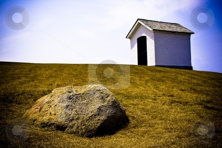 White Shed with Rock in Foreground stock photo, Landscape in Montauk NY. Processed as direct positive effect. by Seph Daradar