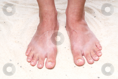 Toes in the sand stock photo, A closeup of feet in the sand by Vince Clements