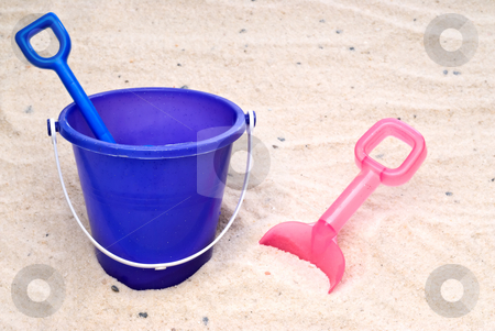 Children's beach toys in sand stock photo, Children's beach toys in sand by Vince Clements