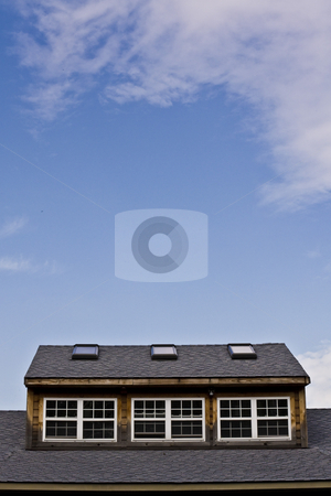 Roof detail with small windows stock photo, At the local park by Seph Daradar