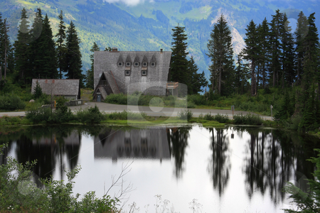Mountain Lake stock photo, A mountain lake with the reflection of an alpine lodge. by Steve Stedman