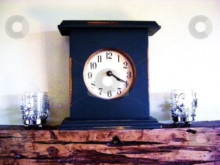20 past 4 clock stock photo, on a mantlepiece with two candles either side by George Thurgood Howland