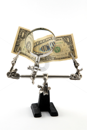 Dollar banknote stock photo, Looking through magnifying glass to the dollar banknote by Csaba Zsarnowszky