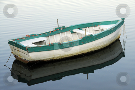 Small fishing boat stock photo, Small fishing boat floating on the water by Csaba Zsarnowszky