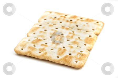 Cracker isolated on white background, studio shot. stock photo, Cracker isolated on white background, studio shot. by Pablo Caridad