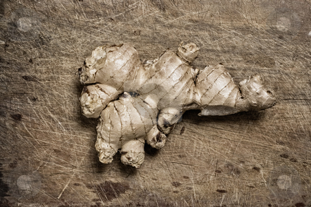 Ginger rhizome isolated on a wooden table. stock photo, Ginger rhizome isolated on a wooden table. by Pablo Caridad