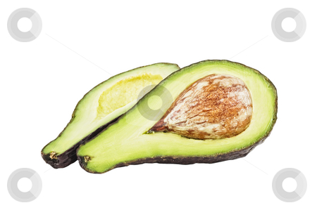An avocado cut in two pieces, white background. stock photo, An avocado cut in two pieces, white background. by Pablo Caridad