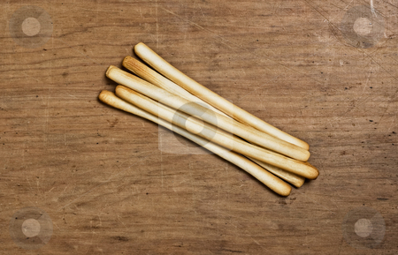 Bunch of Bread sticks stock photo, Bunch of Bread sticks on a wooden table. by Pablo Caridad