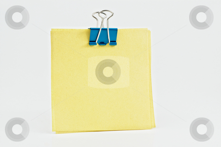 Post it with metal clip on white background. stock photo, Post it with metal clip on white background. by Pablo Caridad