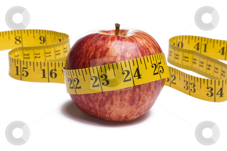 Apple with Tape Measure stock photo, Apple with tape measure around on white background by Mike Dykstra