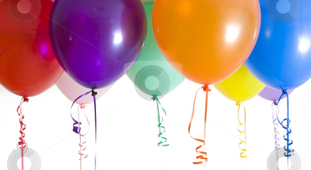 Close Up of Variety of Balloons Brightly Lit stock photo, Close up of variety of balloons with ribbons brightly lit by Mike Dykstra