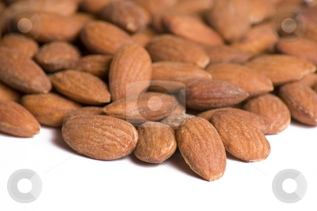 Almonds on White Background stock photo, Close up of almonds set on a white background by Mike Dykstra
