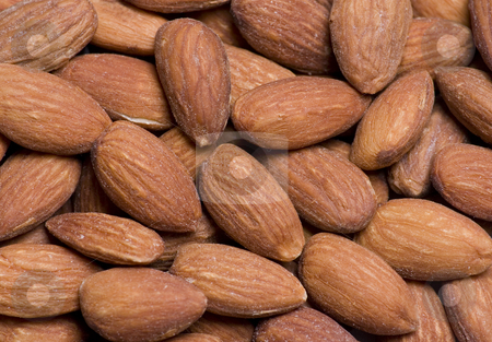 Almonds Close Up stock photo, Close up of almonds suitable for a background by Mike Dykstra