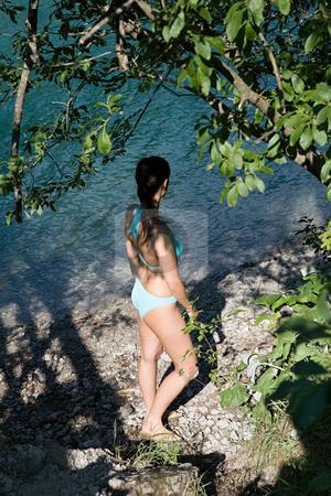 Female at the lake stock photo, Woman wearing a bikini by Mpixis World