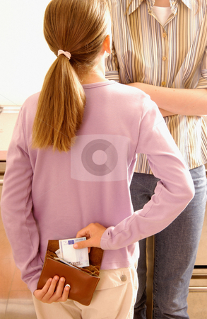 Girl stealing money from mother stock photo, Girl stealing money from mother by Mpixis World