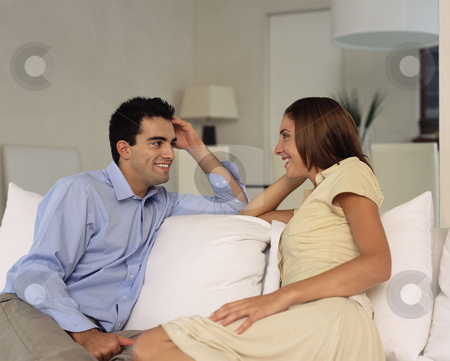 MPIXIS653067 stock photo, Couple talking on sofa by Mpixis World