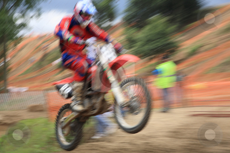 Motorcross rider in motion stock photo, Motorcross rider, abstract image created with intentional motion blur and zooming effect. by Tilo