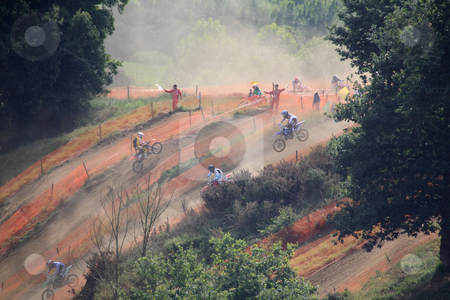 Motorcross in the dust stock photo, Motorcross competitors in the dust by Tilo