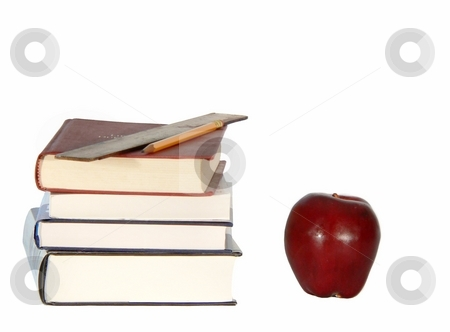 Books and Apple stock photo, Back-to-school themed - stack of books and red apple by Perry Correll