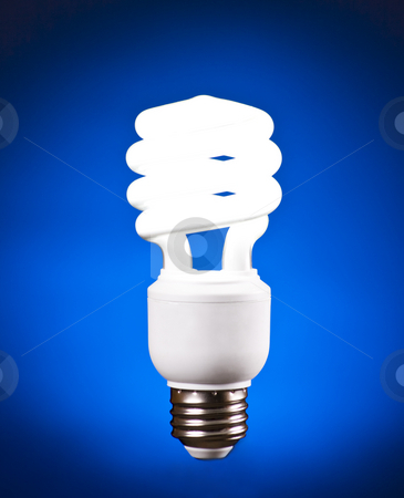 Compact Fluorescent Light Bulb stock photo, Compact Fluorescent Light Bulb on Blue Background by Mike Dykstra