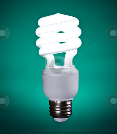 Compact Fluorescent Light Bulb stock photo, Compact Fluorescent Light Bulb on Green Background by Mike Dykstra