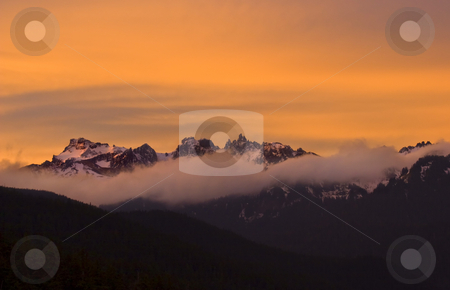 Goat Rocks Sunrise stock photo, The first hint of morning  light dances over the Goats Rocks on a crisp autumn morning. by Mike Dawson
