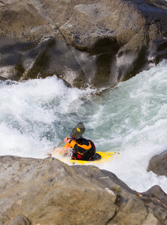 In the Slot stock photo, A kayaker in the slot between huge boulders along the Wenatchee River by Mike Dawson