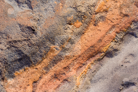 Red Vein stock photo, A vein of red, likely iron deposits within cliff of lava rock along the North Coast of Maui, Hawaii by Mike Dawson