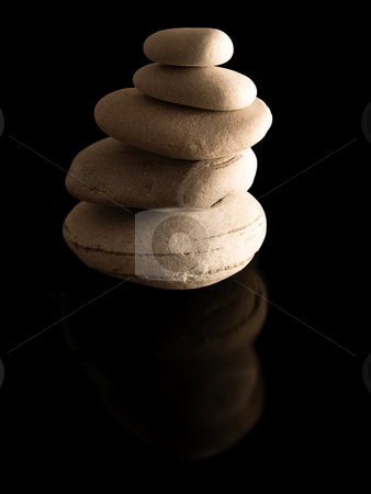 Zen stones pile stock photo, Zen stones pile  on reflective black surface by Laurent Dambies