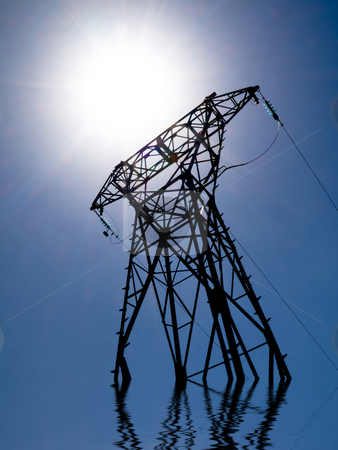 Electriciy power and sun stock photo, Electricity transformer and sun with water reflection by Laurent Dambies