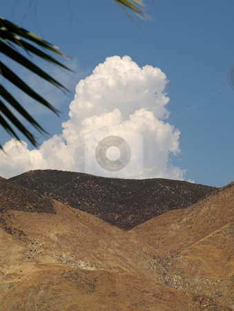Billowing Clouds Over Hills stock photo, Billowing clouds moving over hills by Joseph Ligori