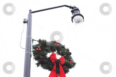 Christmas Wreath stock photo, A Christmas wreath on an outdoor lamp post. by Robert Byron