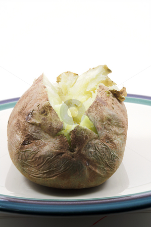 Baked Potato stock photo, A delicious baked potato ready to be eaten. by Robert Byron
