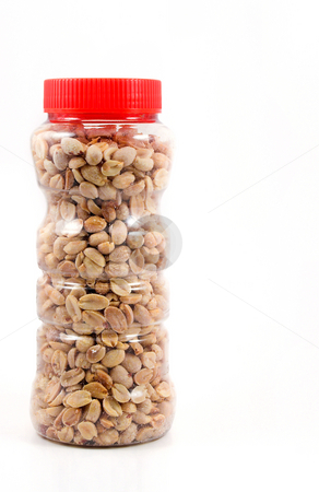 Peanuts stock photo, A jar full of delicious peanuts unless you're allergic to them. by Robert Byron
