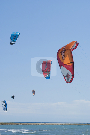 Kites stock photo, Colored kites in the blue sky of French Riviera. by Serge VILLA