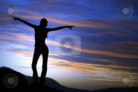 Accomplishment stock photo, A young woman exults the onset of the vivid sunset in french riviera. by Serge VILLA