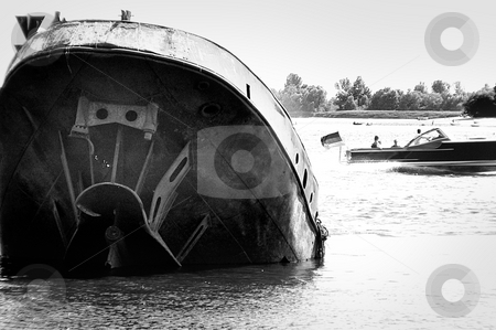 Motorboat and wreck stock photo, A motorboat is passing a wreck by Heiko Riemann