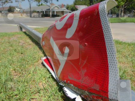 Broken stop sign stock photo, A fallen stop sign, next to the road. by Rob Wright