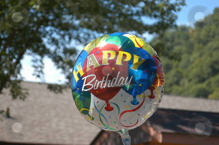 Happy birthday ballon stock photo, A mylar happy birthday ballon at a party by Tim Markley