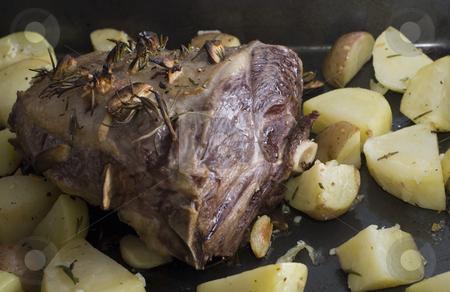 Roast lamb stock photo, A lamb shank and roast potatos by Stephen Gibson