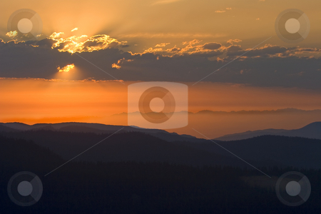 Heavenly Rays stock photo, Beautiful layers formed by the many ridges of the Cascade Mountains from Ravens Roost as a wonderful display of heavenly light unfolds. by Mike Dawson