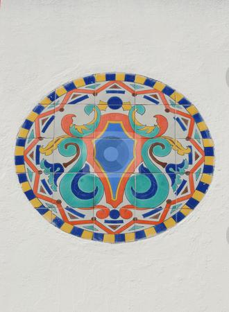 Tile Mosaic On White Wall  stock photo, Ceramic Tile Mosaic or Ornament On White Facade Wall by Denis Radovanovic