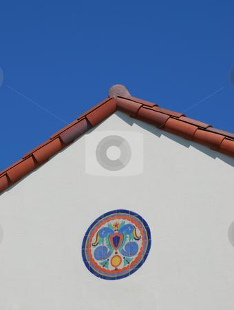 Tile Mosaic Below Red Roof stock photo, Ceramic Tile Mosaic On White Facade Wall Below Red Roof by Denis Radovanovic