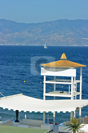 Beach detail - resque tower stock photo, Fancy lifeguard tower on a beach in Calabria near strait of Messina by Natalia Macheda