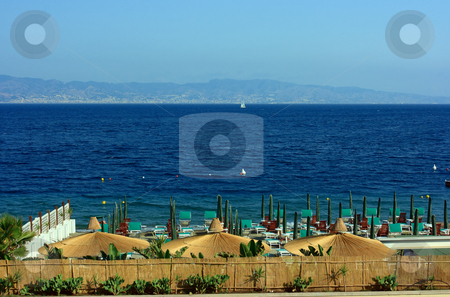 Beach against Sicily stock photo, Beach in Reggio Calabria with the view on Messina strait by Natalia Macheda